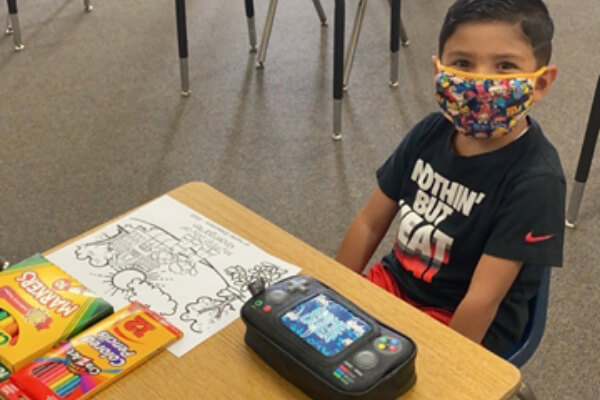School child wearing face mask in the classroom 2020