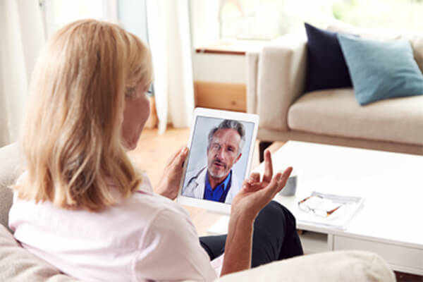 Female patient using video chat telehealth app for doctor visit